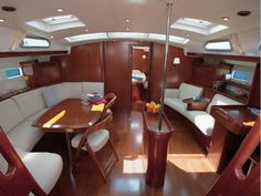 This is a Beneteau Oceanis 523 built in 2007. I love the Beneteau outside look, I hat the interior. The wood is very dark and the interior layout is poorly designed. You have a chair in the middle so you can t use it 90% of the time at sea. There is something in the middle, you wonder why and what it is. Not a fan.