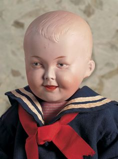 Rare German bisque dimpled laughing character boy by Gebrüder Heubach, circa 1915, marked 7644 Heubach (sunburst) Germany.