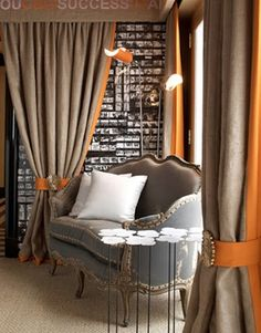 burlap curtains trimmed in orange