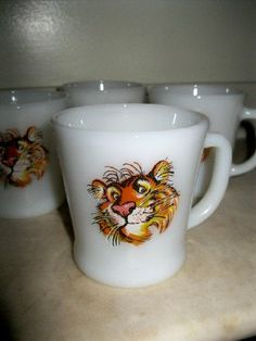 Put a tiger in your tank FireKing mugs by JunqueandStuffe on Etsy, $12.99