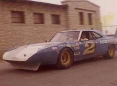 Norm Nelson's Superbird outside Milwaukee Mile. Crew Chief Jerry Kulwicki behind the wheel, Alan's father.