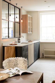 Stained black wood-paneled kitchen: The Marylebone London Galley by Simon Cox for DeVol | Remodelista