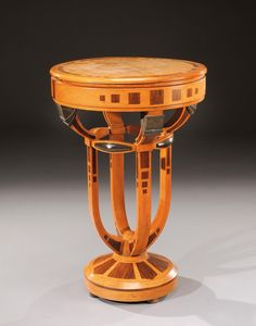 Pedestal table in mahogany and exotic wood veneer with a circular top, opening by two hatches. Circa 1930. H : 29 ½ Diam : 19 2/3 in.