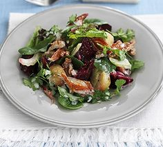 Warm mackerel & beetroot salad 450g new potatoes, cut into bite-size pieces 3 smoked mackerel fillets, skinned 250g pack cooked beetroot 100g bag mixed salad leaves 2 celery sticks, finely sliced 50g walnut pieces  For the dressing 6 tbsp good-quality salad dessing 2 tsp creamed horseradish sauce