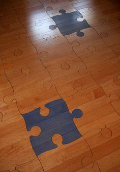 Puzzle wood floor. Interlocking, wood parquet floor in a real puzzle pattern. Fun, unique, casual flooring that will surely make everyone smile who enters the room! :) #puzzle #woodpuzzle #puzzlefloor #parquet #parquetry #pattern #woodtile #woodfloor #wood #woodworking #woodfloordesign #interiordesign #art #design #floor #functionalart #hardwoodfloor