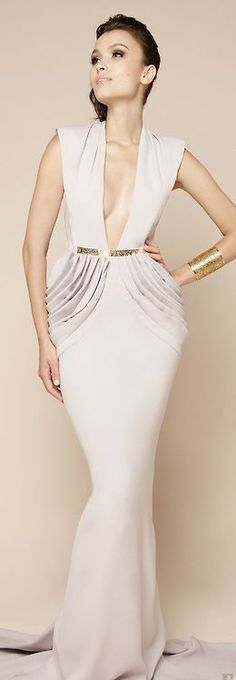 Deep cleavage on this gorgeous Dina Jsr white evening gown
