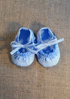 love the idea of baby slippers made out off this fabric in different colors.