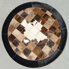 Get this Round Cowhide Area Rug for your home today