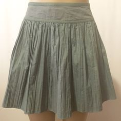 """Armani Olive Green Cotton Pleated Mini Skirt Armani Jeans pleated fit and flair mini skirt. Featuring dropped yoke waistband with cotton details, soft pleated cotton skirt. Invisible side zipper closure  28"""" waist 15' length 72"""" sweep  100% cotton  Made in Italy  Perfect condition Armani Jeans Skirts Mini"""