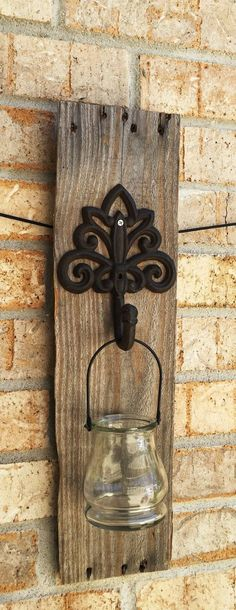 This is a wall sconce born from reclaimed pallet wood, iron and glass! This sconce complements rustic and shabby chic décor beautifully. Each