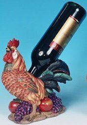 "Rooster Wine Bottle Holder by Collectible Badges. $19.95. 7 "" X 4 "" X 10 "" High. Bold-Bright Colors. Holds Any Reg Size Bottle (Bottle Not Included). Dark Rust Tones. Made Of Nice Quality Resin. 7 "" X 4 "" X 10 "" High-Made Of Nice Quality Resin-Bold-Bright Colors-Dark Rust Tones-Holds Any Reg Size Bottle (Bottle Not Included)-Rubber Feet On Base-Great Gift Idea-Great Conversation Piece For The Bar. Save 33% Off!"