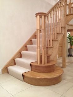 Beautiful turned ash staircase with oversized curtail step feature