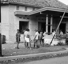 Street scene in Surabaya (Soerabaja) during a lull in the fighting. Note the nationalist graffiti on the walls. Surabaya, British, Java, Graffiti, History, Couple Photos, Street, Walls, Scene