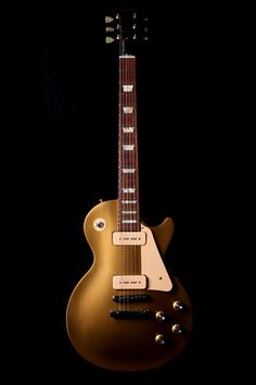 1956 Gibson Les Paul Gold Top with P-90 pickups. This guitar in original condition (as seen here) is worth more then your car, and maybe even your house.