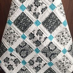 Again, this is so simple, but I love it. Another black, white and teal quilt. So very graphic.