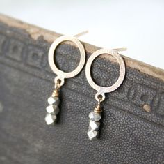 Silver and Gold Earrings - Modern Gold Circle Posts with Sterling Nuggets. 26.00, via Etsy.