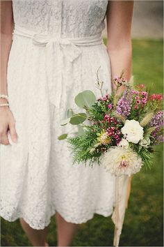 Especially love the greenery to match Matt's boutineer!  wildflower wedding bouquet from Flower Afternoon