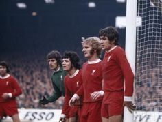 Liverpool goalkeeper Ray Clemence is joined in defence by Kevin Keegan Alec Lindsay and Emlyn Hughes circa 1974