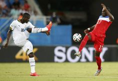 Ghana's Jonathan Mensah fights for the ball against Jozy Altidore of the U.S. during their 2014 World Cup Group G soccer match at the Dunas ...