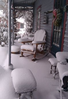 A snow covered porch from a house in the Central Taconics during the day after Christmas blizzard of 2010