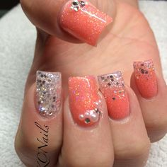 Coral/peach and silver acrylic nails. Pearl and rhinestone accents. Solid and reverse fade  KCNails