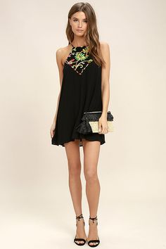 Lulus Exclusive! Bring a bit of paradise with you wherever you roam in the Piece of Caicos Black Embroidered Shift Dress! Adjustable spaghetti straps top an apron neckline bedecked in green, yellow, and orange embroidery, plus multi colored pompoms. Woven, shift bodice has a keyhole with top button at back.