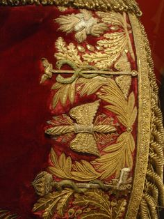 Elegant gold embroidery on red velvet - part of French off… | Flickr