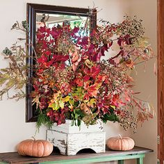 Fall Foliage Arrangement   The key to arranging leaves is to group them by size and color as you would flowers. Fiery red maple makes a beautiful focal point when countered with the feathery foliage of dawn redwood laden with globes of gray-green fruit on the fringes.