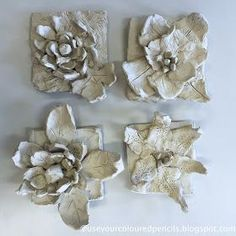 These flower sculptures were created by grade 3 students in paper clay. Elementary art lesson