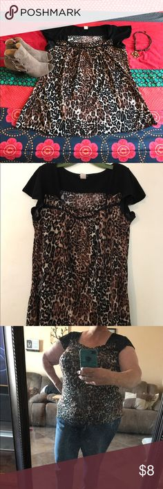 Leopard Print Top Cute and comfy top. Very stretchy material. Short little cap sleeves, a bit fluttery.  Subtle ruffle detail along front of shirt. Mash me washable. 98% polyester, 8% spandex. Goes well with jeans, a skirt or dress pants. Perseption Women Tops