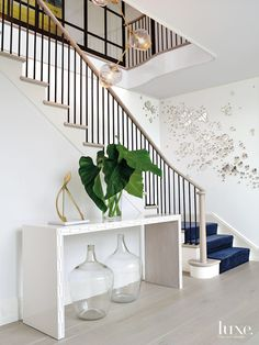 Modern white staircase with mirrored butterfly wall décor Staircase Wall Decor, White Staircase, Staircase Design, Entryway Decor, Staircase Remodel, Entryway Ideas, Stair Railing, Stairs, Railings