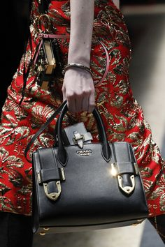 Milan Fashion Week - Prada AW16 Accessories from their Ready-to-Wear Show - black top handle bag with gold buckle detail...x