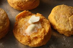 SWEET POTATO BISCUITS -- 2 cups all-purpose flour  1 tablespoon baking powder  1 tablespoon granulated sugar  1/2 teaspoon fine salt  1/4 teaspoon baking soda  3/4 cup whole milk  1 cup baked, mashed sweet potato (about 1 medium potato)  8 tablespoons unsalted butter (1 stick), frozen  Heavy cream for brushing the tops  INSTRUCTIONS  Heat the oven to 400°F and arrange a rack in the middle. Combine all dry ingredients in a large mixing bowl and set aside. In a separate large bowl, mix…