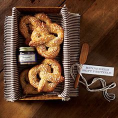 Benne Seed Soft Pretzel | Pack pretzels in a decorative box or basket that the hostess can reuse, and line it with fabric. Secure our custom label to a small wooden spreader to complete the gift. | SouthernLiving.com