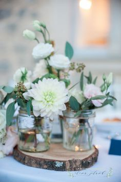 Collections of jars on log slices make super cute table centres. By Le Coeur Sauvage