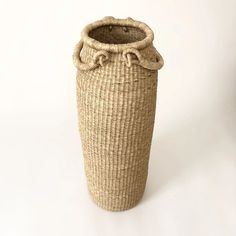 Pre-Order for early June delivery. Extra tall column basket with two handles. Handwoven from elephant grass by female artists in northern Ghana, each basket takes a week to create. Hand Weaving, Elephant, Handle, This Or That Questions, Baskets, Hand Knitting, Hampers, Elephants, Basket