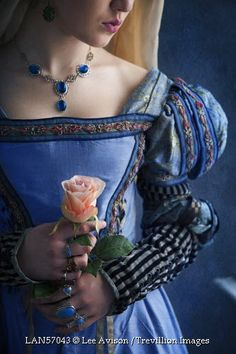 © Lee Avison / Trevillion Images - tudor-medieval-woman-with-rose