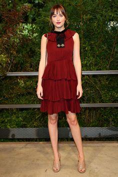 Dakota Johnson - Getting a jumpstart on one of Spring 2016's biggest trends, Dakota Johnson chosea burgundyruffled dressfor the Gucci show.