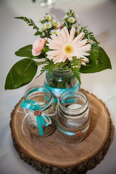 Mason Jar centerpiece with natural wood charger, ribbon and button