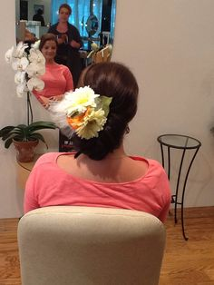 Low bun with flowers #enzoriccobenesalon