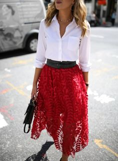 New York fashion blogger wearing a classic white collared button down and red embroidered and applique lace midi skirt with studded black waist belt black ankle strap sandals and a small m2malletier handbag for creative office workwear style