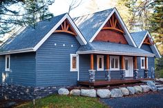 For over 40 years Cedarland Homes has been the builder of beautiful homes and cottages in the Parry Sound, Muskoka and Georgian Bay regions. Blue Siding, Blue Roof, Cottage Exterior, Paint Colors For Home, Exterior Paint, House Painting, Custom Homes, Beautiful Homes, Building A House