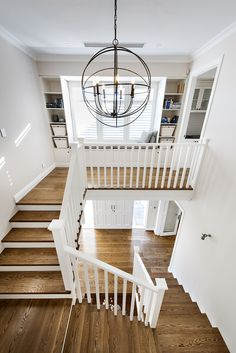 Hamptons style staircase with orb chandelier - Oswald Homes