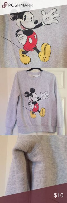 Mickey Mouse crewneck sweatshirt Crewneck sweatshirt. New. Never worn. Didn't realize I'd bought a medium. This fits but a large would have been perfect. It's a heather gray/oatmeal color. H&M Tops Sweatshirts & Hoodies