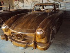 "Teak wood 1955 Mercedes-Benz 300SL Replica. Wooden car, wooden engine; unfortunately, ""wooden"" work! -- by ??"