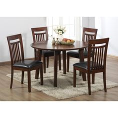 An antique oak finish adds a timeless quality to this sturdy wooden table. With a versatile design, this set is the perfect addition to your dining room or kitchen.