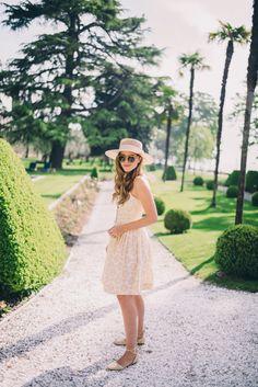 Gal Meets Glam Mornings on Lake Garda - Anthropologie dress, Preston & Olivia hat, J.Crew flats, and Illesteva sunglasses