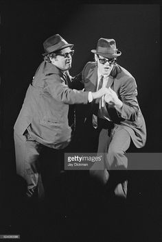 John Belushi and Dan Aykroyd dancing together as Jake and Elwood Blues during their Blues Brothers act.