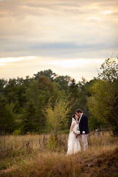 Bride and groom photo in a field #weddingphotography #weddings www.linkedringweddings.com