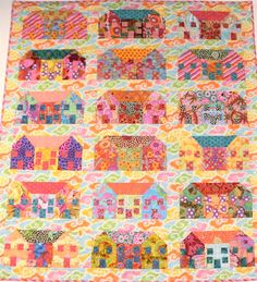 From Kaffe Fassett fabrics.  What a great use of his fabrics! I saw it in his book, but it had a more subtle background.